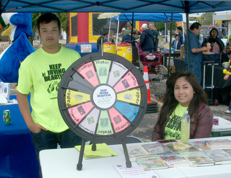 Volunteers with KIB used games like the spinning wheel, where attendees answer questions about recycling and the environment, to raise sustainability awareness. Photo courtesy of Keep Irving Beautiful.