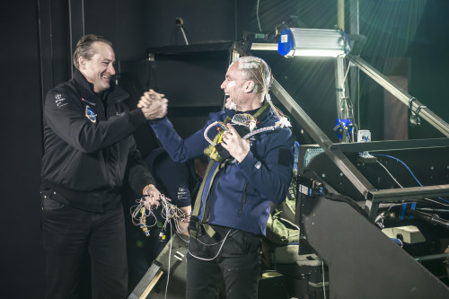 André Borschberg and Bertrand Piccard shake hands after Bertrand successfully completes the 72 hour flight simulation. Courtesy photo