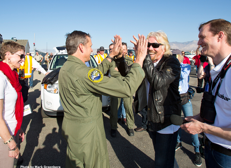 Sir Richard Branson and Mark Stucky congratulate each other after the success of Virgin Galactic's first rocket-powered flight.  Photo by Mark Greenberg