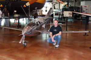 At Frontiers of Flight Museum, Justin Lewis poses with his FLS Microjet which he flies at  air shows around the country. / Photo by Elaine Paniszczyn