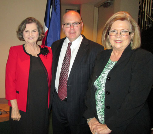 George W. Bush Presidential Library Director Alan C. Lowe stand with Kaye Ward (left), Irving Heritage Society VP of Programs, and Heritage Society President Janice Carroll (right). Lowe spoke to the Society recently about the inner workings of presidential libraries. Courtesy Photo.