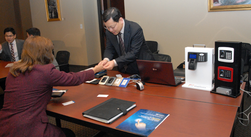 Hosang Lee, President of Gajeon, inc., a Korean biometric security systems company, greets Deborah McVean, the City of Irving's M/WBE (Minority/Women Business Enterprise) Programs Coordinator. Photo by Phil Cerroni.