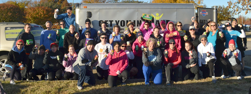 Participants at the 2012 Turkey Busting Workout celebrate after raising donations and their heartbeats for charity. Photo courtesy of Get You In Shape.