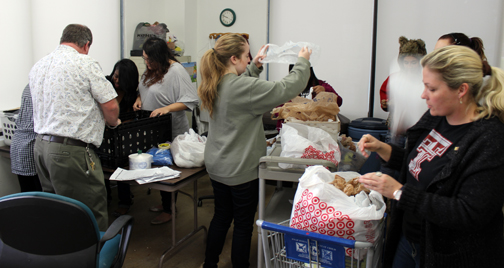 Volunteers from Winfree Academy sort donations to Irving Cares. Photo courtesy of Winfree Academy.