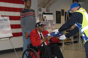 Taking time to meet a part  of living history, people line  up to greet Tuskegee Airman,  Sgt. Homer Hogues, following  a Memorial Day flag folding  ceremony. / Photo by John Starkey