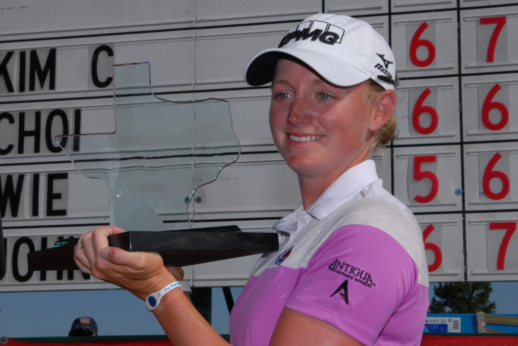 Stacy Lewis, winner of the North Texas LPGA Shootout, stands triumphantly with her  trophy at the awards ceremony held May 4 at the Las Colinas Country Club. Lewis is a  texas native and a six-year veteran golfer. Lewis took home a whopping $195,000 for  her title win during the Shootout. / Photo by John Starkey