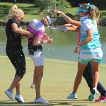 North Texas LPGA Shootout Champion Stacy Lewis (left-center) is showered after her win by Natalie Gulbis (left), Lexi Thompson (right), and Alison Walshe (covered) on Sunday, May 5, at Las Colinas Country Club.