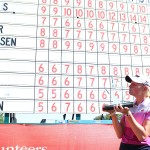 Stacy Lewis kisses the championship trophy in front of the leaderboard following her victory at the 2014 North Texas LPGA Shootout on Sunday, May 5, at Las Colinas Country Club.