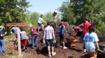 Volunteers disburse 'mountain of mulch' at nature park