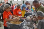 Church, charity pack 20,000 meals to battle hunger